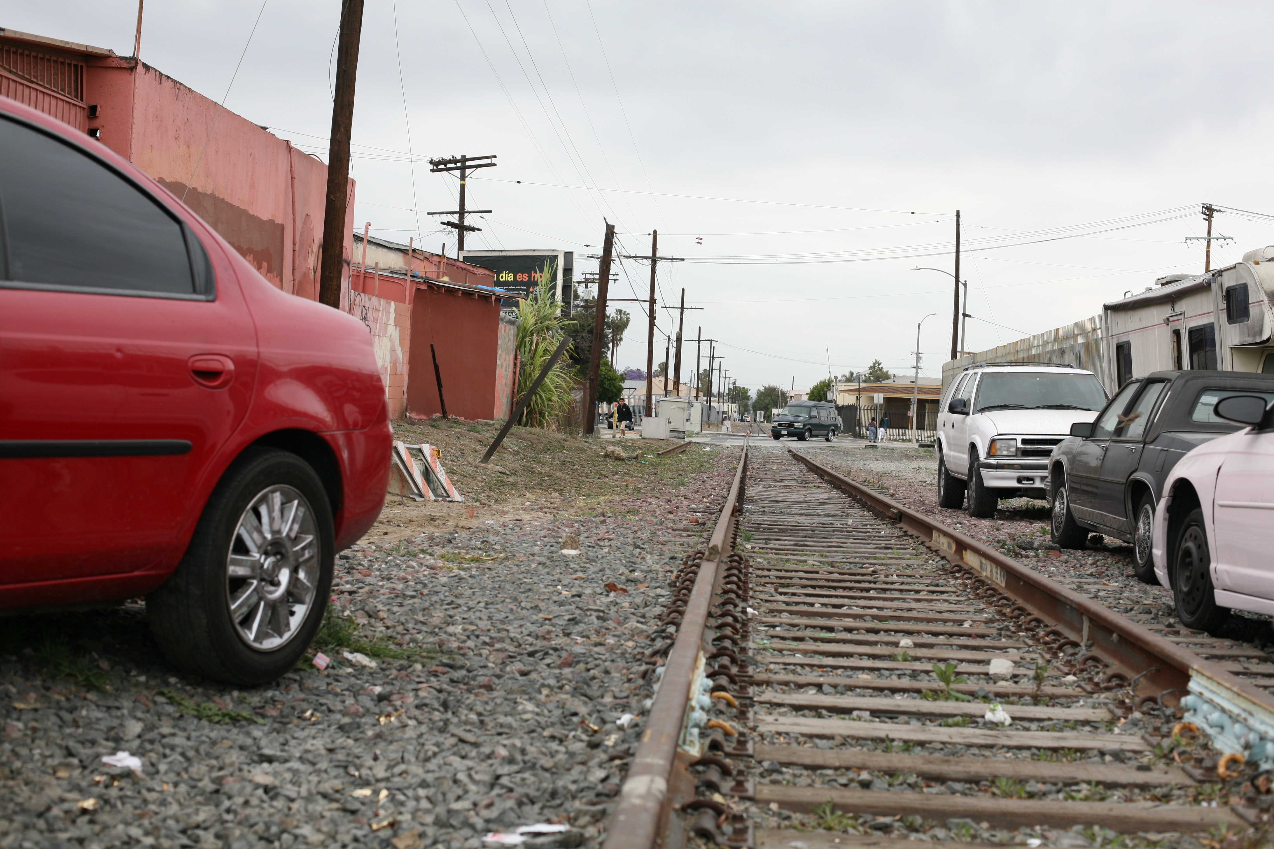 Abandoned train tracks line the road in South Los Angeles